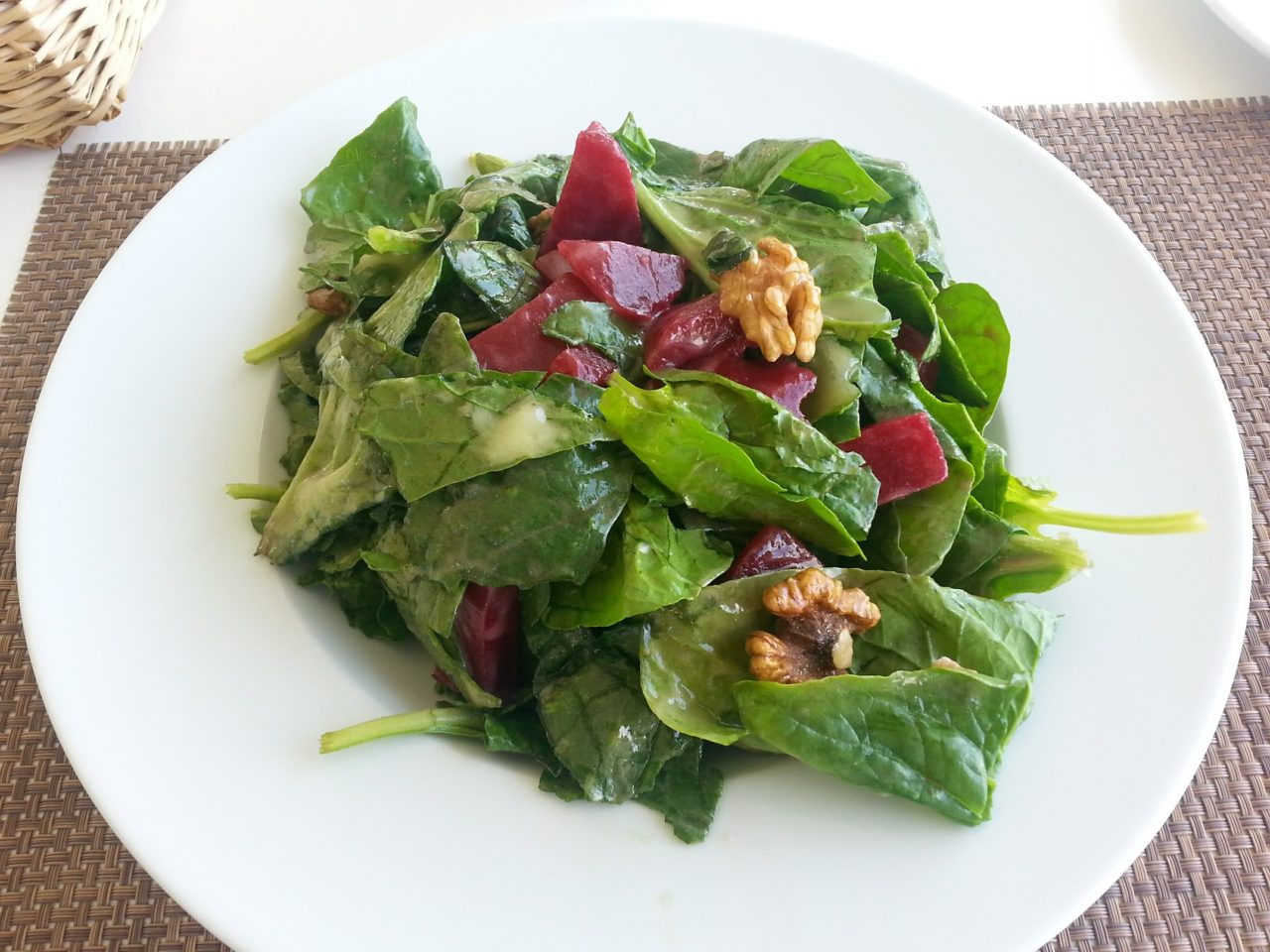 Beet salad on bed of greens
