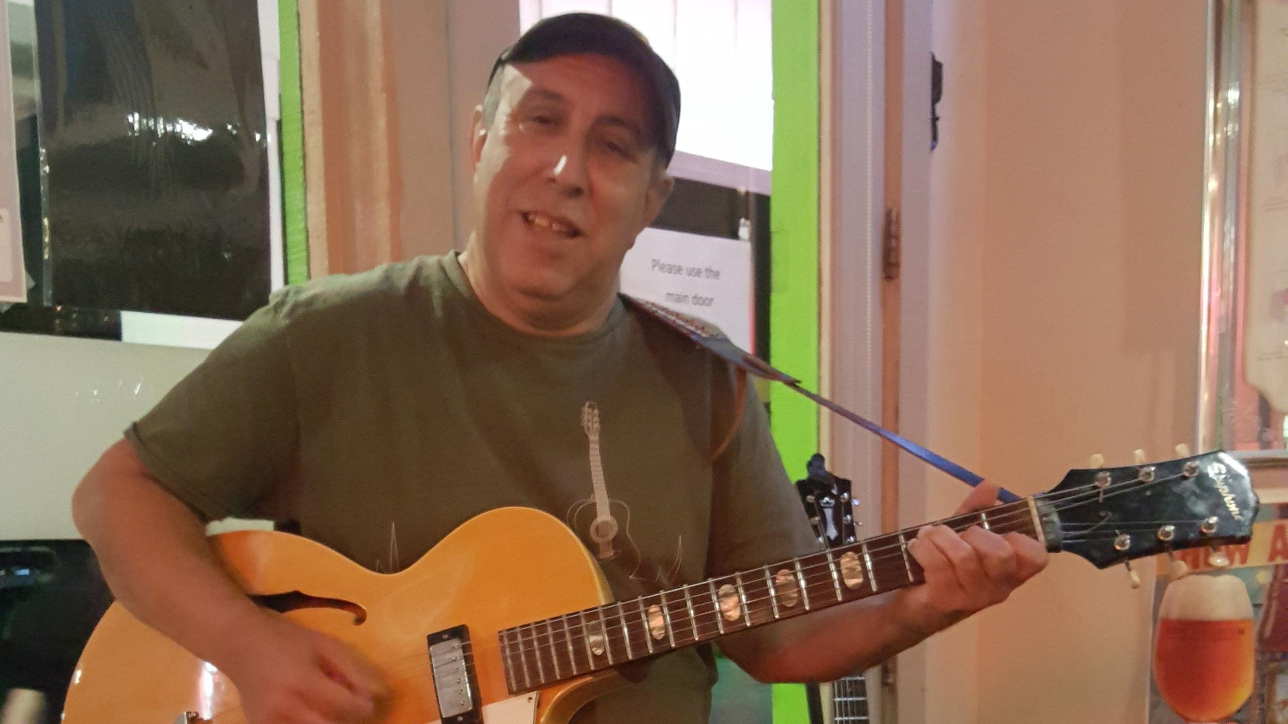 Coastal Steve playing guitar