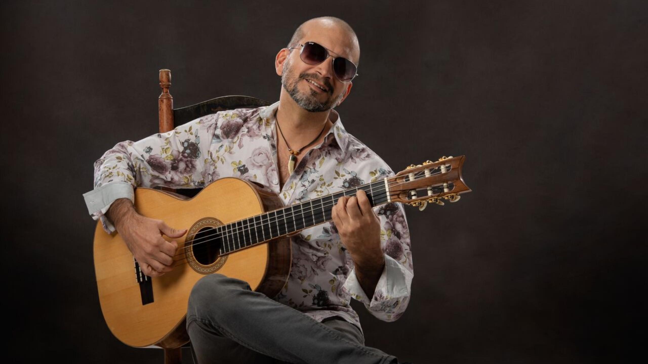 David Munoz, guitarist, plays during Sunday Brunch