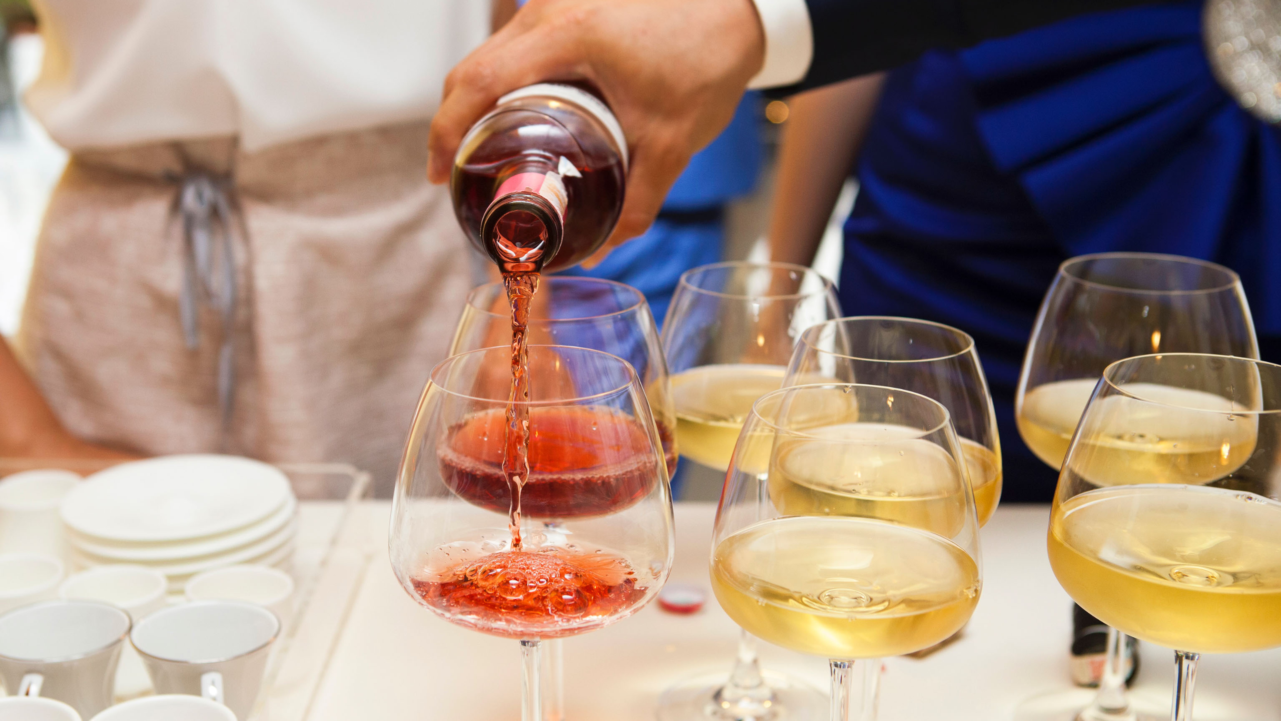 wine being poured into glasses